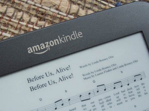Photo of a Kindle screen displaying sheet music with a double image of the song title