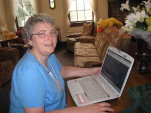 Photo of Linda Bonney Olin working on her laptop computer at 2012 Montrose Christian Writers Conference